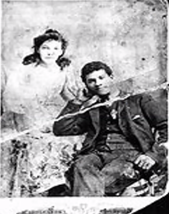 A 19th-century black and white photograph of a couple posing for the camera