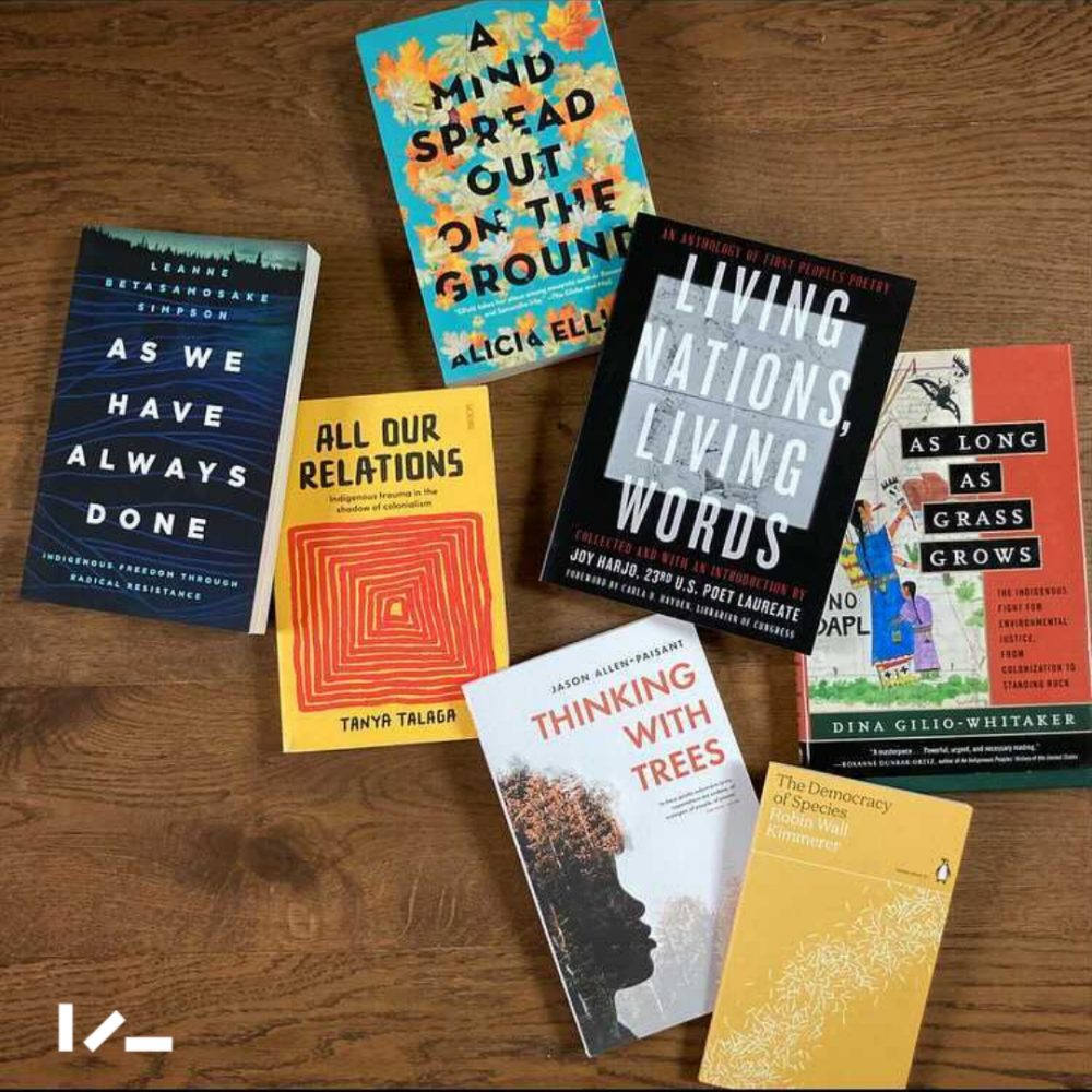 [Image description: A selection of books on wooden floor: 'As We Have Always Done', 'A Mind Spread Out On the Ground', 'All Our Relations', 'Living Nations, Living Words', 'As Long As The Grass Grows', 'Thinking With Trees', 'The Democracy of Species']
